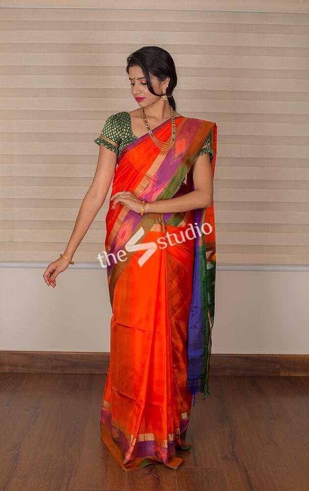 Orange soft silk saree with ikat border
