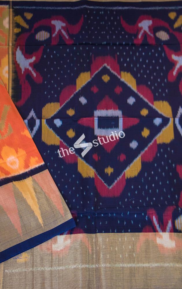 Orange ikat kora silk cotton saree with navy blue pallu