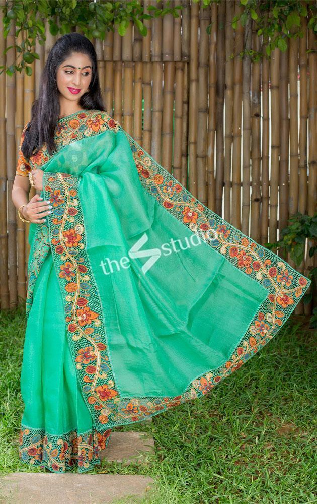 Sea green organza cutwork saree